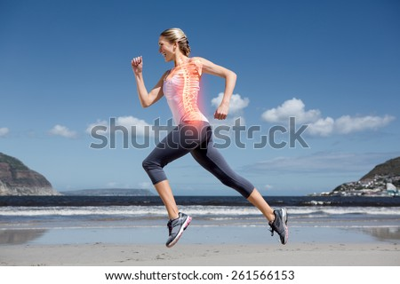 Digital composite of Highlighted back bones of jogging woman on beach - stock photo