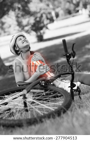 Digital composite of Highlighted bones of injured cyclist - stock photo