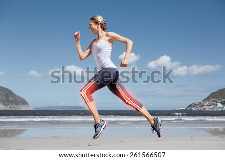 Digital composite of Highlighted leg bones of jogging woman on beach - stock photo
