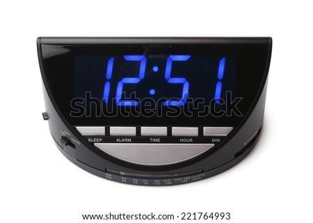 Digital electronic clock on white background - stock photo