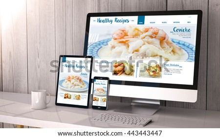 Digital generated devices on desktop, responsive recipes blogdesign on screen. All screen graphics are made up. 3d rendering. - stock photo