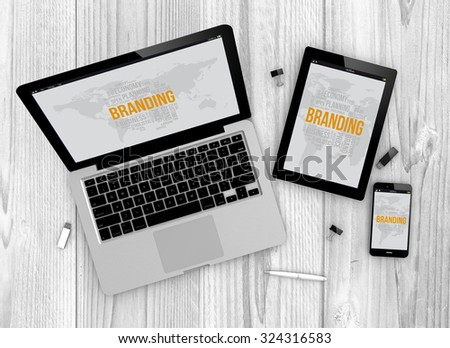 Digital generated devices over a wooden table. laptop, tablet and white smartphone with made up branding interface. - stock photo
