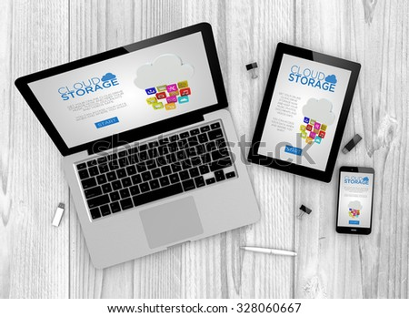 Digital generated devices over a wooden table. laptop, tablet and white smartphone with made up cloud storage interface. - stock photo