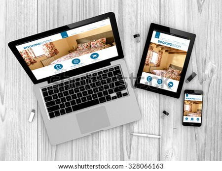 Digital generated devices over a wooden table. laptop, tablet and white smartphone with made up responsive booking website . - stock photo