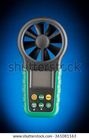Digital handheld anemometer isolated on blue background - stock photo