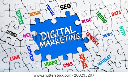 digital marketing concept with pieces of puzzle showing related tags  - stock photo