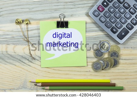 digital marketing writing in sticky note. pen, euro and calculator. business concept - stock photo