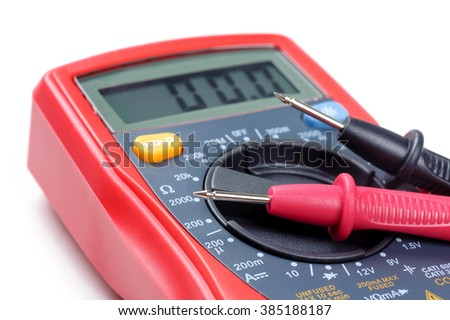 digital multimeter or multitester or Volt-Ohm meter (closeup at test leads), an electronic measuring instrument that combines several measurement functions in one unit. - stock photo