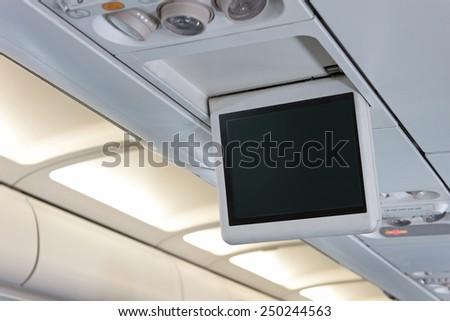 Digital screen in plane - stock photo