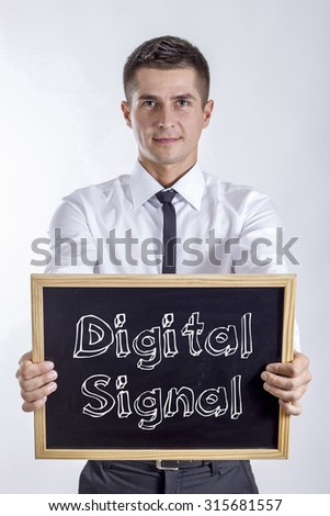 Digital Signal - Young businessman holding chalkboard with text - stock photo