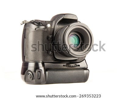 Digital SLR camera with vertical battery grip and small lens attached over white background - stock photo