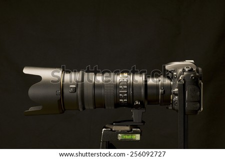 Digital SLR With Powerful Zoom Shot On Black Background - stock photo