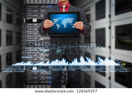 Digital tablet and graph in data center room - stock photo