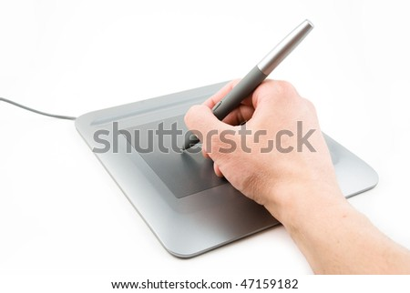 digital tablet and pen in a hand - stock photo