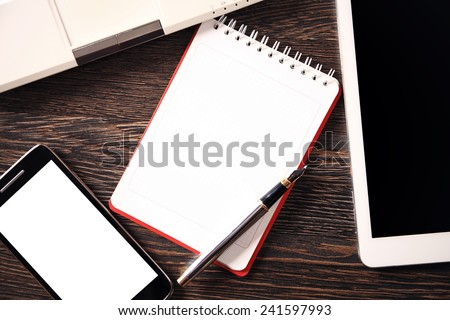 Digital tablet computer on old wooden desk. Simple workspace or coffee break with web surfing.  - stock photo