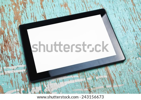 Digital Tablet Computer with Blank White Screen as Copy Space on Office Desktop. - stock photo