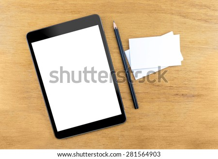 Digital Tablet computer with empty screen,Business card and black pencil on wooden table, Mock up for adding your design, Clipping path on screen and business card - stock photo