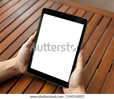 Digital tablet computer with isolated screen in male hands over cafe background - stock photo