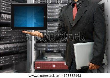 Digital tablet in data center room - stock photo