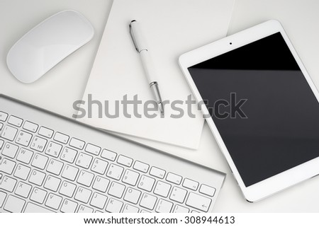 Digital tablet keyboard, notebook, pen top view - stock photo