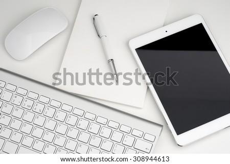 Digital tablet keyboard, notebook, pen top view - stock photo