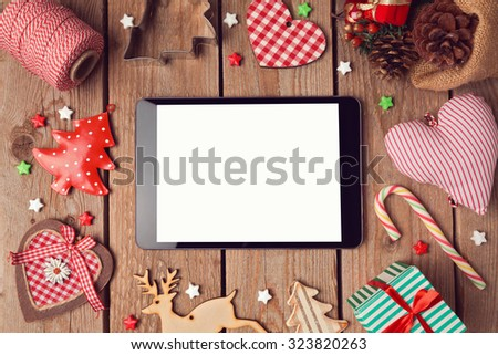 Digital tablet mock up with rustic Christmas decorations for app presentation - stock photo