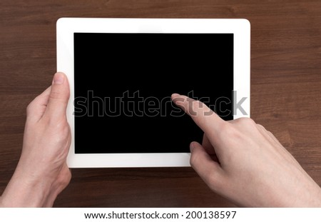 Digital tablet on wooden tablets gesture control - stock photo