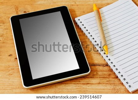 Digital tablet pc on business desk with blank white screen - stock photo