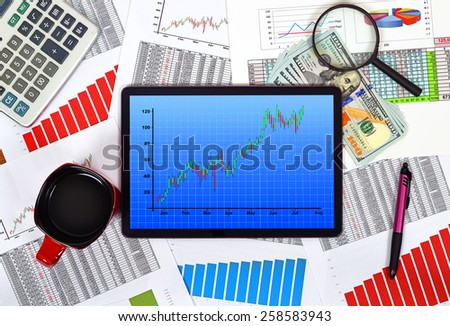 digital tablet with stock chart on the table businessman - stock photo