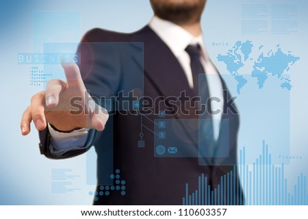 Digital technology for the business application, a business man using a touchscreen for finance purpoise, diagram and histogram - stock photo