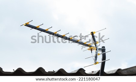 Digital TV Antenna on the roof, sunny day. - stock photo