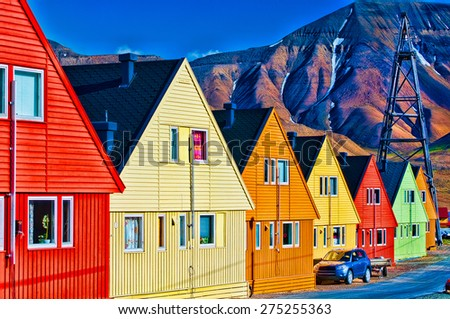 Digitally enhanced row of very colorful homes in Longyearbyen, Svalsbard, Norway. - stock photo