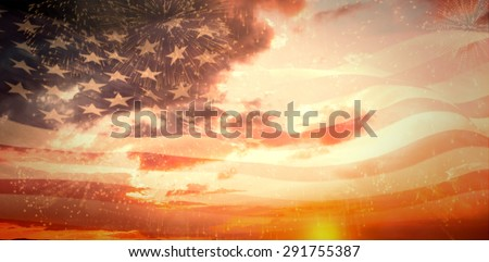Digitally generated american flag rippling against colourful fireworks exploding on black background - stock photo
