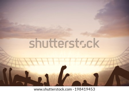 Digitally generated football stadium with cheering crowd - stock photo