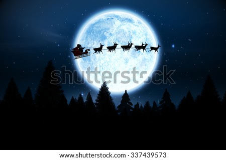 Digitally generated Santa flying over night sky - stock photo