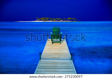 Digitally manipulated image of an adirondack chair sitting on the end of dock surrounded by deep blue water with an deserted island in the background. - stock photo