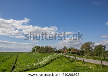 Dike along the dollard route in Ostfriesland, Germany - stock photo