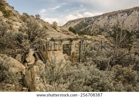Dilapidated building built of stone in a ghost town in Utah - stock photo