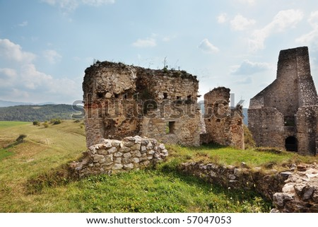 Dilapidated medieval fortress in the spring in Slovakia - stock photo