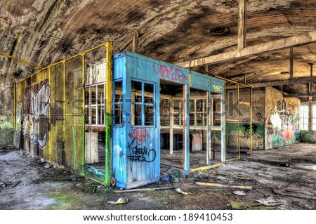 Dilapidated office booth in an abandoned factory, hdr processing - stock photo