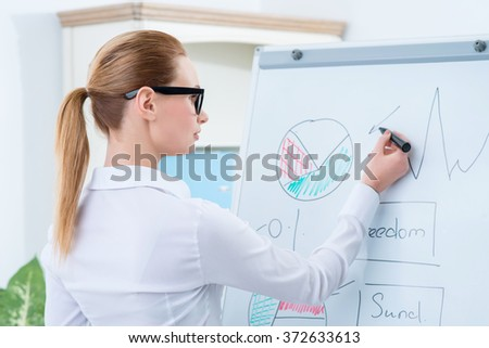 Diligent woman preparing her project  - stock photo
