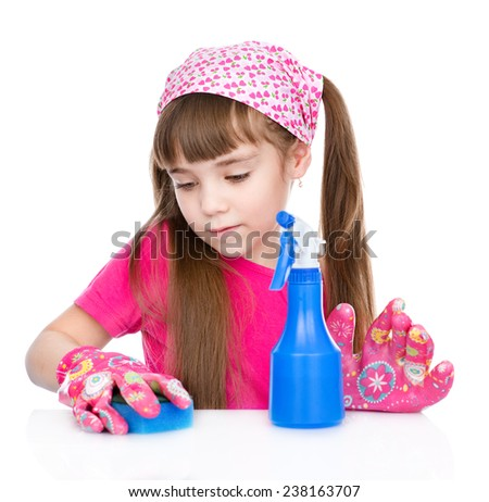 diligent young girl is tidying up the house. isolated on white background - stock photo