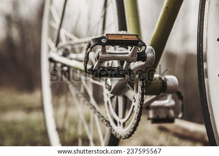 Dim image of bicycle and its pedal - stock photo