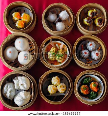 dim sum in bamboo steamer, chinese cuisine - stock photo