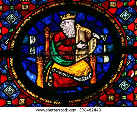 DINANT, BELGIUM - OCTOBER 16, 2011: Stained glass window in the Notre Dame church of Dinant, Belgium, depicting the Hebrew king David. - stock photo