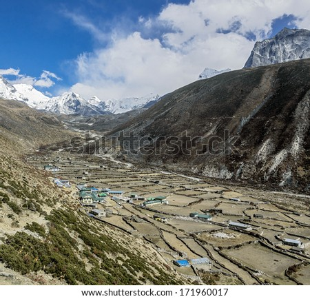 Dingboche village in the Chhukhung valley against the Lhotse peak - Everest region, Nepal, Himalayas - stock photo