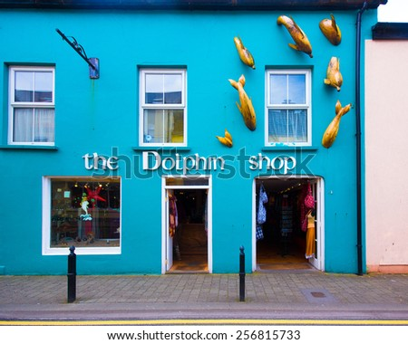 DINGLE, IRELAND - MARCH 29, 2013: View of charming storefront along the streets of Dingle Ireland.  - stock photo