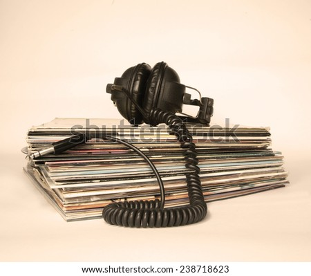 Dingy sepia-style  image of vinyls pile and old headphones - stock photo