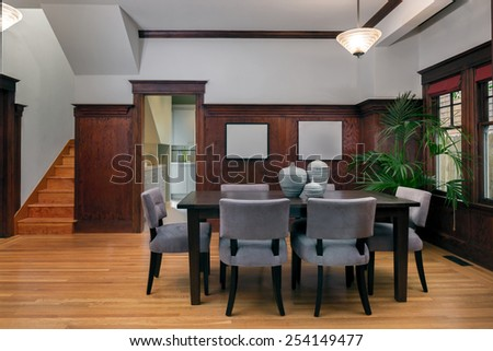 Dining area within refinished craftsman home.  - stock photo