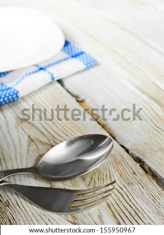 Dining facilities and plate. On wooden board. - stock photo